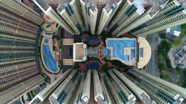 aerial view moving down towards tseung kwan o plaza, new territories, hong kong - swimming pool stock videos & royalty-free footage