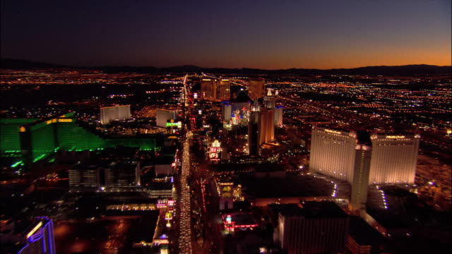 aerial view moving south over traffic on las vegas boulevard south and hotels along the las vegas strip / zoom in on new york, new york and excalibur / night / las vegas, nevada - mandalay bay resort and casino stock videos & royalty-free footage