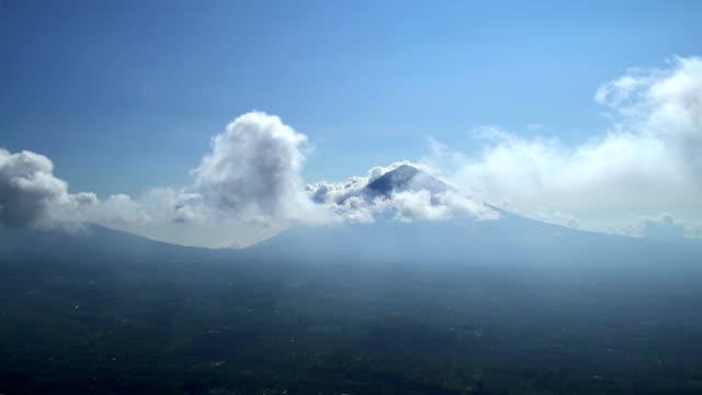 vídeos y material grabado en eventos de stock de aerial view mt agung mountain peak volcano bali - cultura indonesia