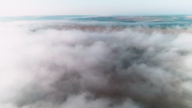 aerial view. nature and cloudscape. mist and fog over the plains creating simplicity and beauty in the landscape. - mindfulness stock videos & royalty-free footage