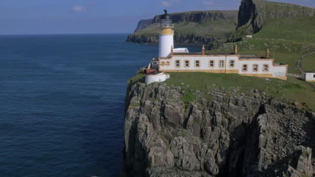 Aerial view Neist Lighthouse people hiking Skye
