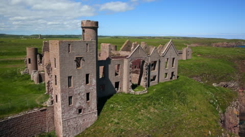 aerial view new slains castle ruins in aberdeenshire, scotland - castle stock videos & royalty-free footage
