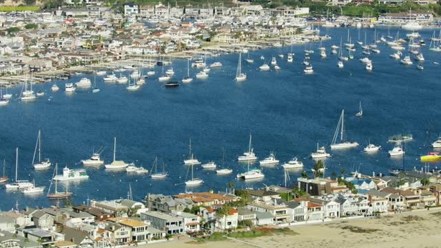 aerial view newport beach pier balboa peninsula california - harbour stock videos & royalty-free footage