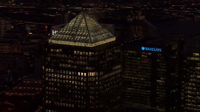 LONDON Aerial view night shots Canary Wharf London City skyline circling buildings incl Citi Bank HSBC JP Morgan and Barclays skyscrapers
