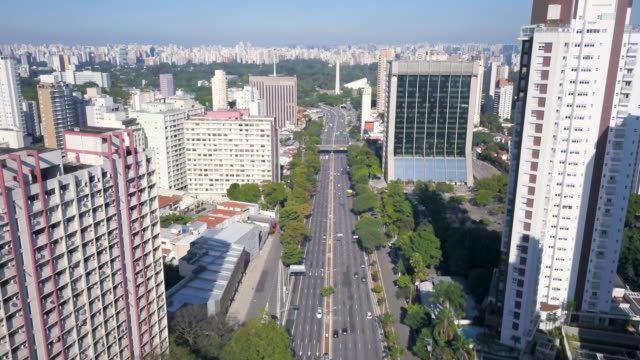 aerial view of 23 de maio avenue and obelisk in sao paulo during covid 19 coronavirus quarantine with drone - avenida stock videos & royalty-free footage