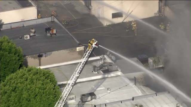 ktla aerial view of 4alarm fire at a strip mall in monterey park on september 23 2015 three firefighters were injured battling the fire one... - centro commerciale suburbano video stock e b–roll
