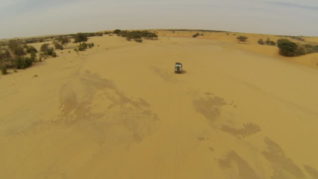 aerial (drone) view of 4x4 truck driving through remote terrain - durability stock videos & royalty-free footage