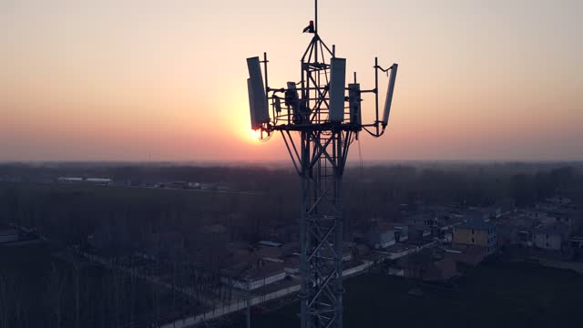 aerial view of 5g communications tower - communications tower stock videos & royalty-free footage