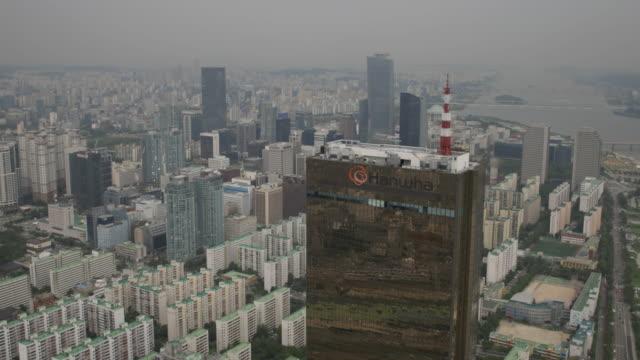 aerial view of 63 building (remain the tallest skyscraper in korea until 2009) and cityscape - 英字点の映像素材/bロール