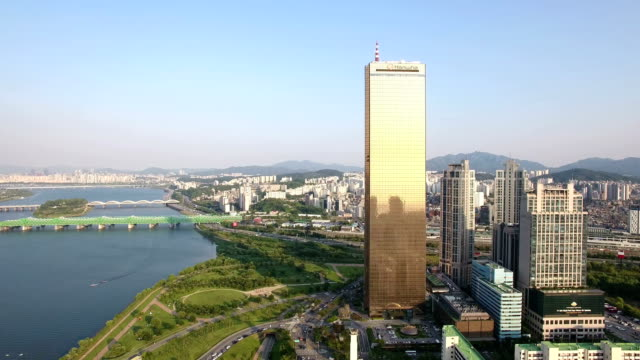 aerial view of 63 building, yeouido park and han river - arch bridge stock videos and b-roll footage