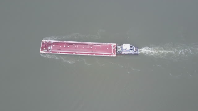 aerial view of a barge and ship on the buffalo bayou in houston texas. - barge stock videos & royalty-free footage