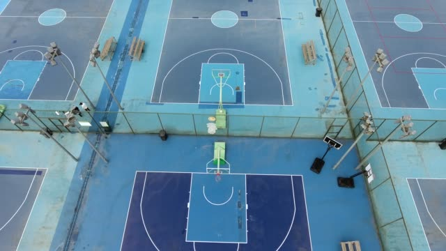 aerial view of a basketball fields in china - court stock videos & royalty-free footage