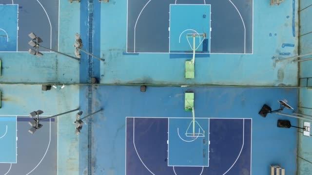 vídeos de stock e filmes b-roll de aerial view of a basketball fields in china - quadra desportiva