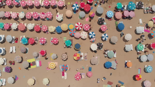 aerial view of a beach with crowd enjoying sea - tourist resort stock videos & royalty-free footage