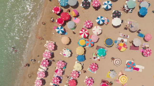 aerial view of a beach with crowd enjoying sea - saturated colour stock videos & royalty-free footage