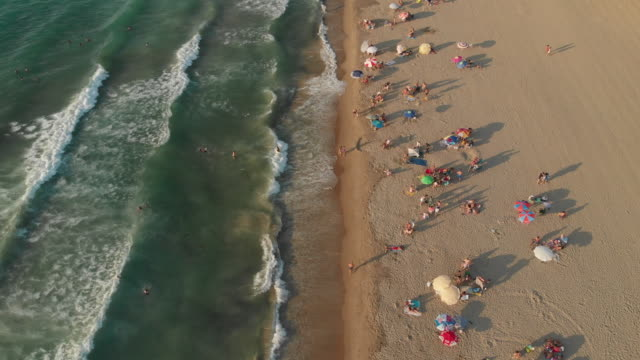 Aerial View of a Beach With Crowd Enjoying Sea