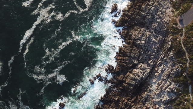 aerial view of a beautiful coastline - terreno accidentato video stock e b–roll