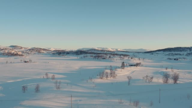 aerial view of a beautiful sunset-lit mountain plateau in telemark, norway. - telemark stock videos and b-roll footage