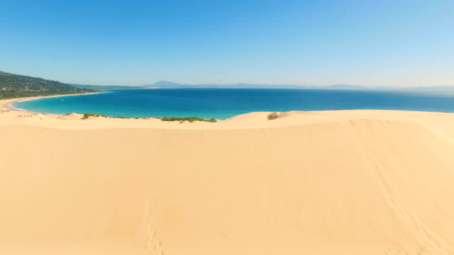 Aerial view of a big dune sand with ocean and Africa coast behind it