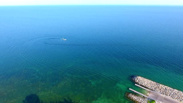 aerial view of a boat on crystal beach at fort erie ontario canada - fort erie stock videos & royalty-free footage