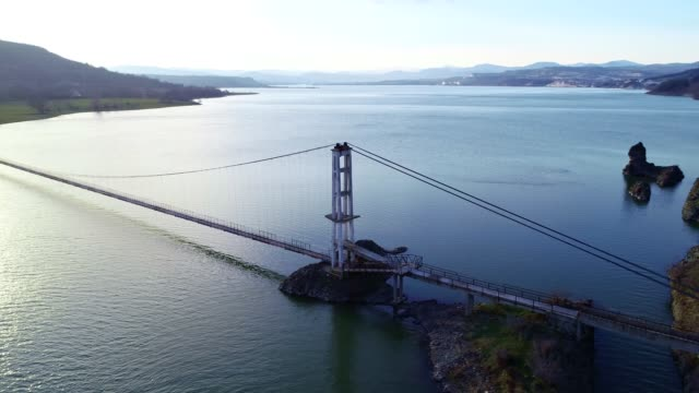 Aerial View of a Bridge Between Two Lands, Jigsaw Metaphor, Connection, Collaboration, Relation, Beauty in Nature, Seascape, Reflection in the Water, Travel Destinations, Walking One Man Only, Cable-Stayed Bridge