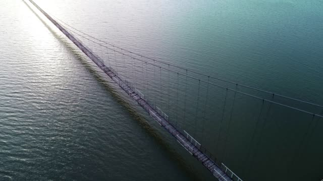 Aerial View of a Bridge Between Two Lands, Jigsaw Metaphor, Connection, Collaboration, Relation, Beauty in Nature, Seascape, Reflection in the Water, Travel Destinations, Walking, Dolly Shot