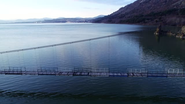 Aerial View of a Bridge Between Two Lands, Jigsaw Metaphor, Connection, Collaboration, Relation, Beauty in Nature, Seascape, Reflection in the Water, Travel Destinations, Drone Pilot, Flyiing,