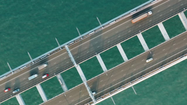 aerial view of a bridge in hong kong with traffic - ship stock videos & royalty-free footage