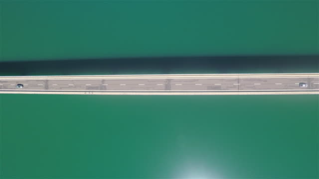 aerial view of a bridge over water reservoir - gerade stock-videos und b-roll-filmmaterial
