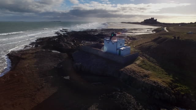 aerial view of a building on the british coast - rocky coastline stock videos & royalty-free footage