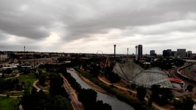 Aerial view of a busy amusement park on a cloudy day in Denver Colorado