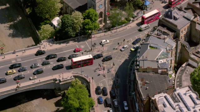 aerial view of a busy bridge road junction in london, uk. 4k - london bridge england stock videos & royalty-free footage