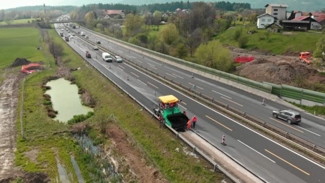aerial view of a busy highway under construction - covering stock videos & royalty-free footage