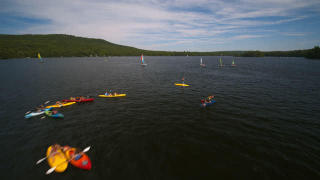 aerial view of a busy lake in maine on a beautiful summer's day - using a paddle stock videos & royalty-free footage
