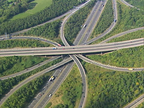 Aerial view of a busy motorway junction. NTSC, PAL