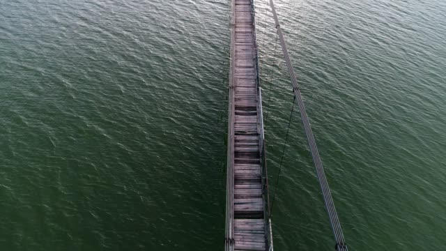 Aerial View of a Cable-stayed Bridge Between Two Lands, Jigsaw Metaphor, Connection, Collaboration, Relation, Beauty in Nature, Seascape, Reflection in the Water, Travel Destinations, Walking,
