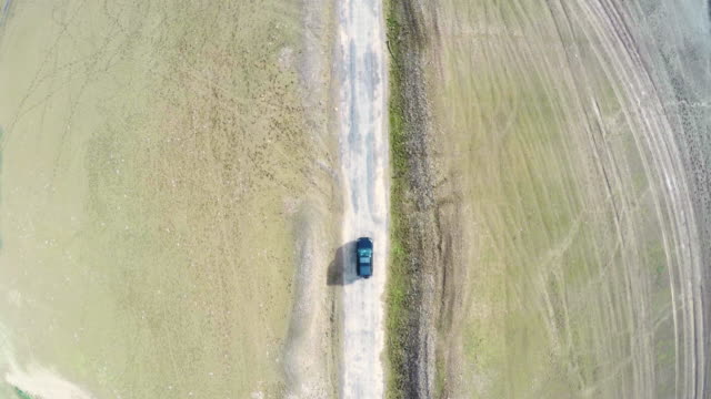 Aerial view of a car on a rural road