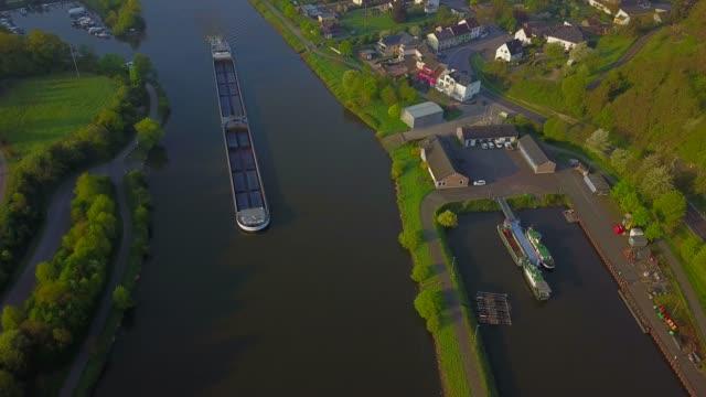 Aerial view of a cargo vessel on Saar river near Saarburg, Rhineland-Palatinate, Germany, Europe