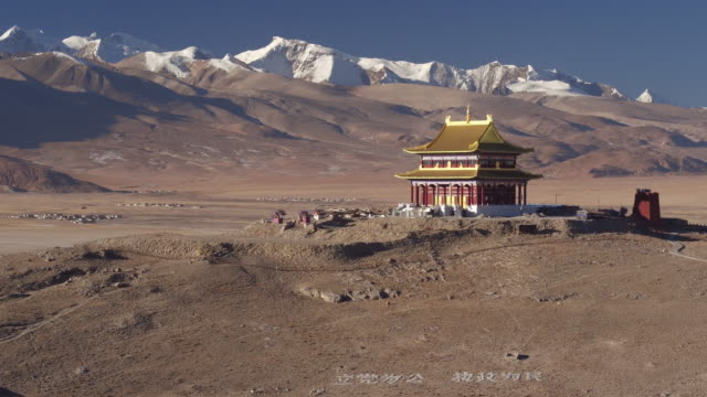 aerial view of a chinese temple and a village in tibet - tibet stock videos & royalty-free footage