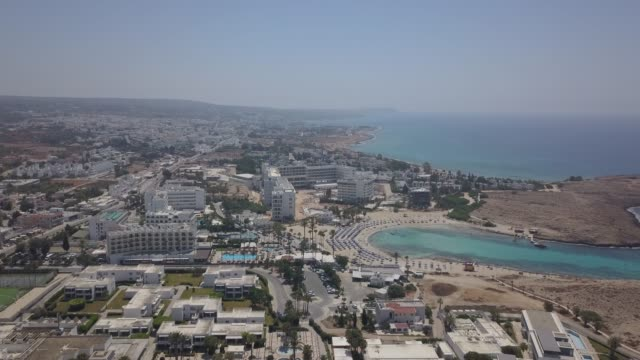aerial view of a closed hotel after not having guests during the reopening of hotels. the main tourist markets of cyprus are closed. . authorities... - republic of cyprus stock videos & royalty-free footage