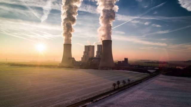 aerial view of a coal fired power station at sunrise - smoke stack stock videos & royalty-free footage
