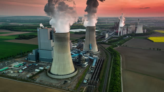 aerial view of a coal fired power station - coal fired power station stock videos & royalty-free footage
