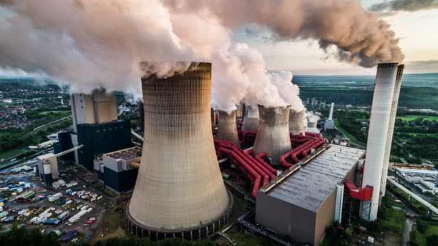 aerial view of a coal fired power station - smoke stack stock videos & royalty-free footage