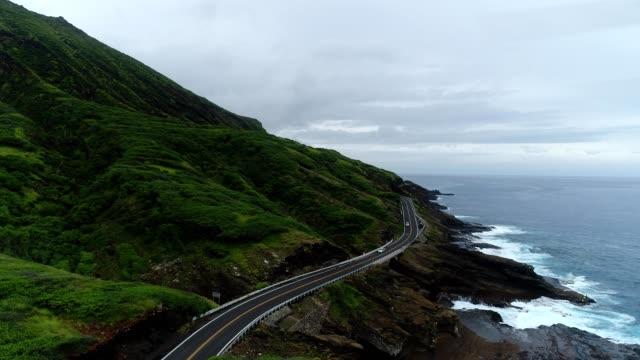 aerial view of a coastal cliff road in honolulu hawaii - honolulu stock videos and b-roll footage