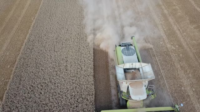 NörtenHardenberg Germany July 17 2018 Aerial view of a combine harvester harvesting a wheat field in midsummer in Germany Due to the drought the...