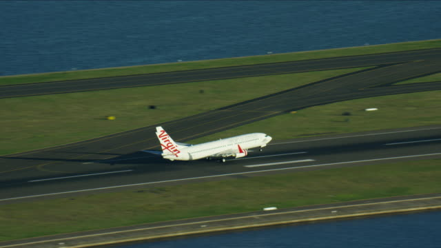 aerial view of a commercial plane taking off - column stock videos & royalty-free footage