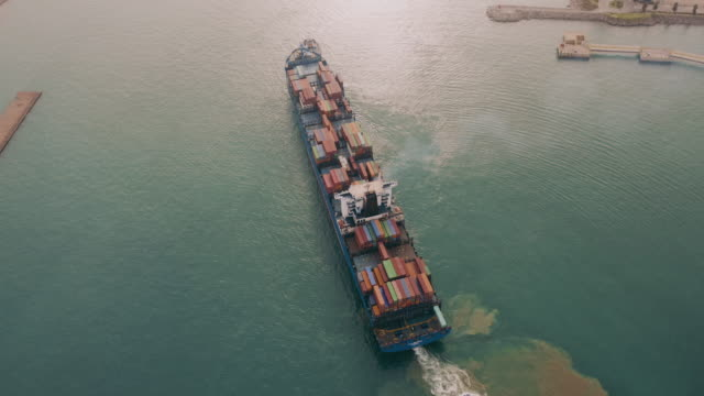 aerial view of a container ship leaving port, freight transportation. - ship stock videos & royalty-free footage