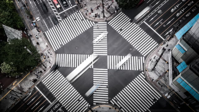 t/l ws ha aerial view of a crossing in ginza / tokyo, japan - crossroad stock videos & royalty-free footage