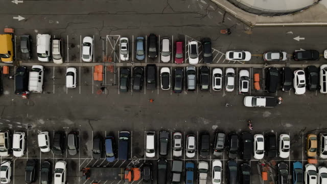 aerial view of a crowded parking lot - parking stock videos & royalty-free footage
