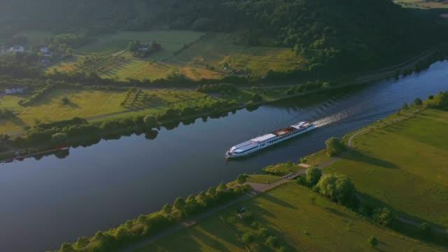 aerial view of a cruise ship on saar river near schoden, saar valley near saarburg, rhineland-palatinate, germany, europe - cruising stock videos & royalty-free footage